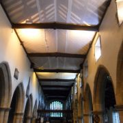 Finished netting installation along length of the church
